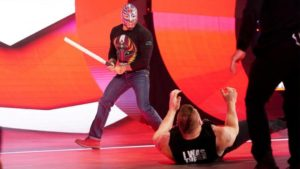 Rey Mysterio launching an unexpected attack on Lesnar