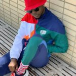 Kizz Daniel cuts his hair