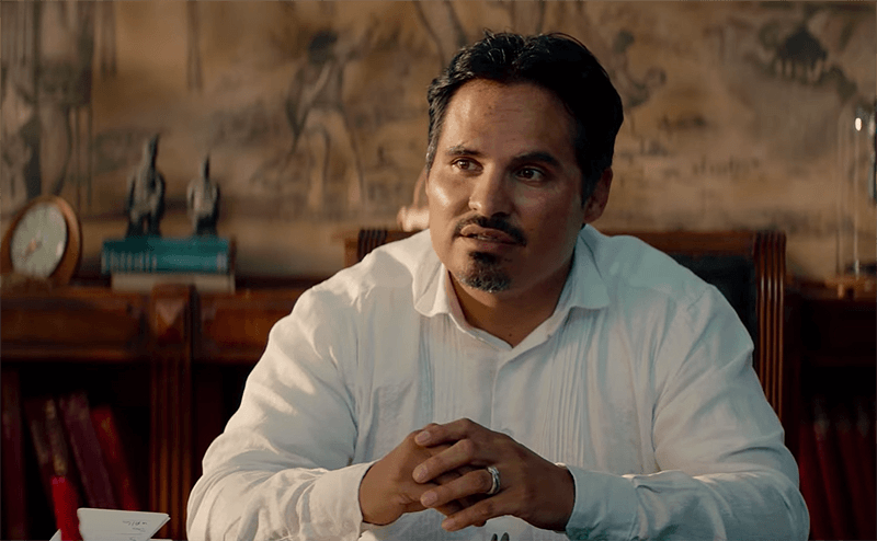 Michael Pena as the mysterious host in the movie