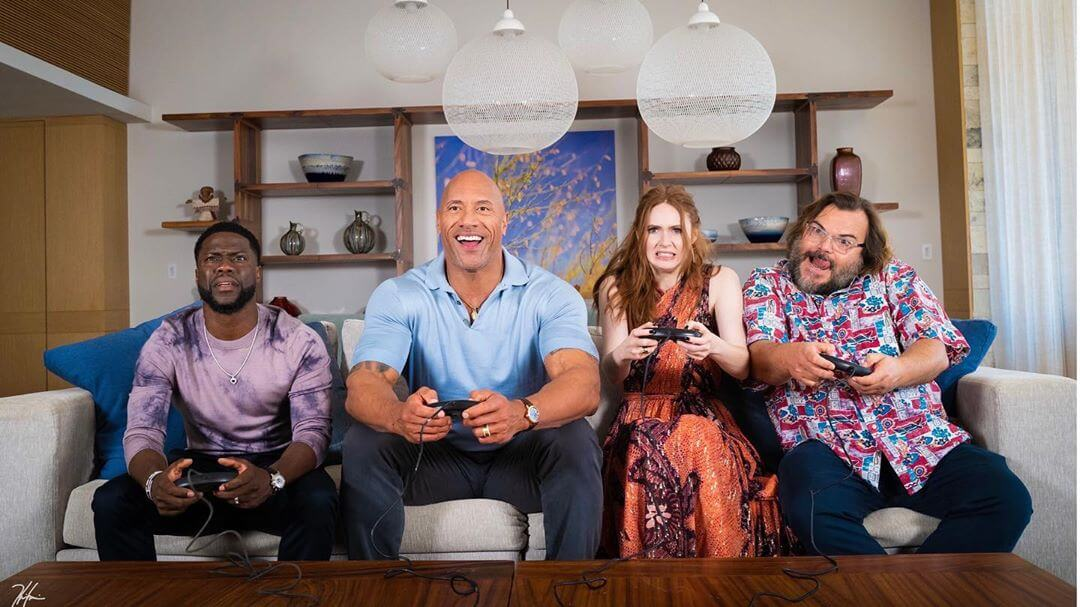 Gillan playing a video game with her Jumanji cast members