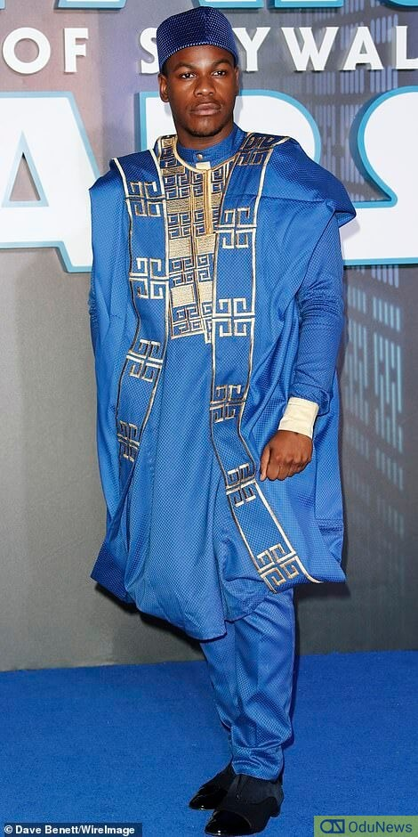 John Boyega proudly shows off his Nigerian attire at the premiere