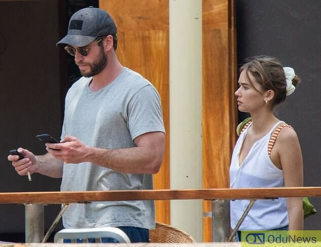 Liam Hemsworth spotted with mystery lady