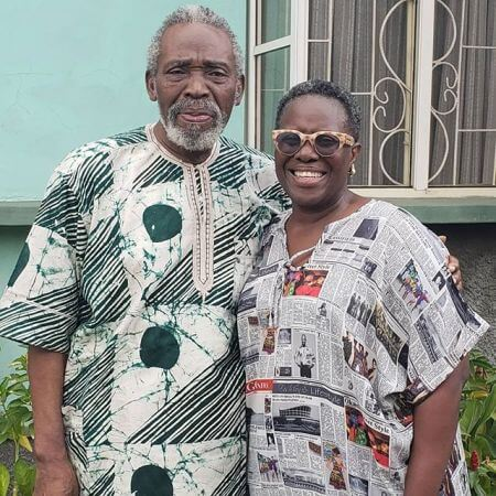With her husband, actor Olu Jacobs