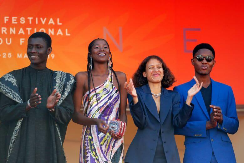 The main cast of Atlantics with French director, Mati Diop