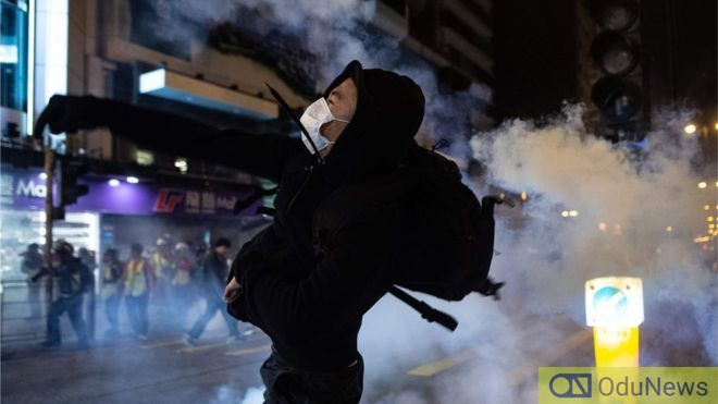tear gas fired on angry protesters in Hong Kong