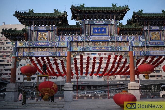 Workers dismantle decorations after the temple fair for the Chinese Lunar New Year in Ditan Park was canceled in Beijing, China January 24, 2020. Carlos Garcia Rawlins/Reuters