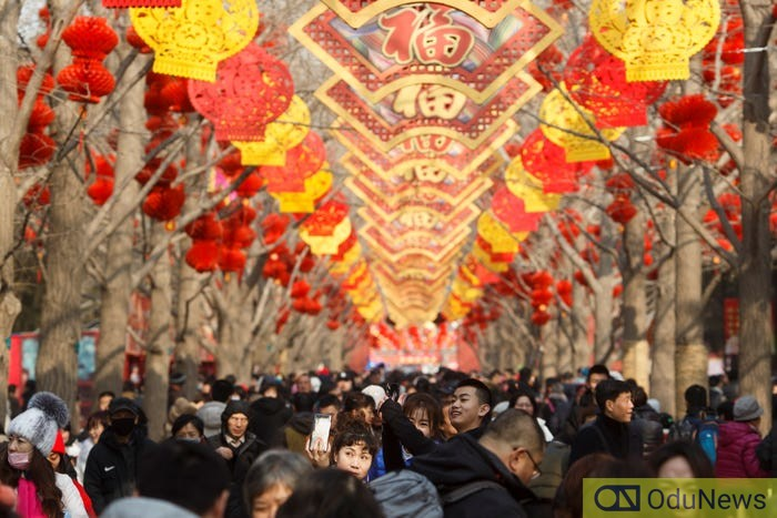People mingle in Ditan Park on the first day of the Lunar New Year of the Pig in Beijing, China, February 5, 2019. Thomas Peter/Reuters