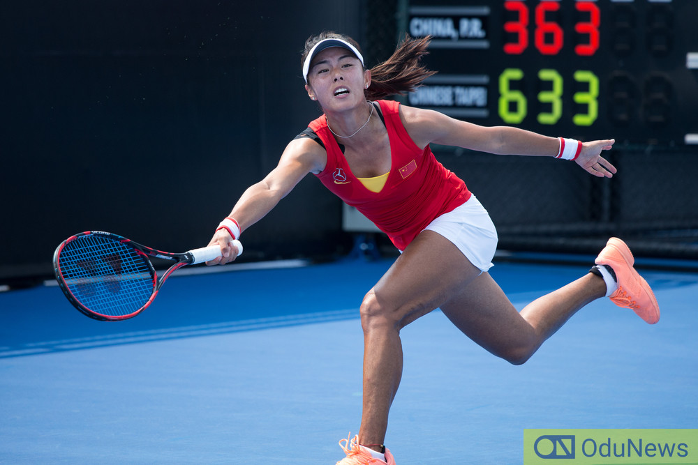 Qiang Wang celebrates her victory against Serena Williams