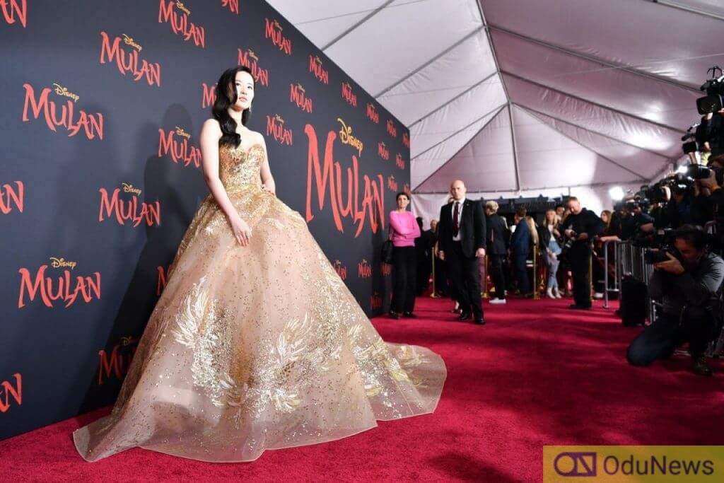 See how stars looked at the premiere of Disney's Mulan