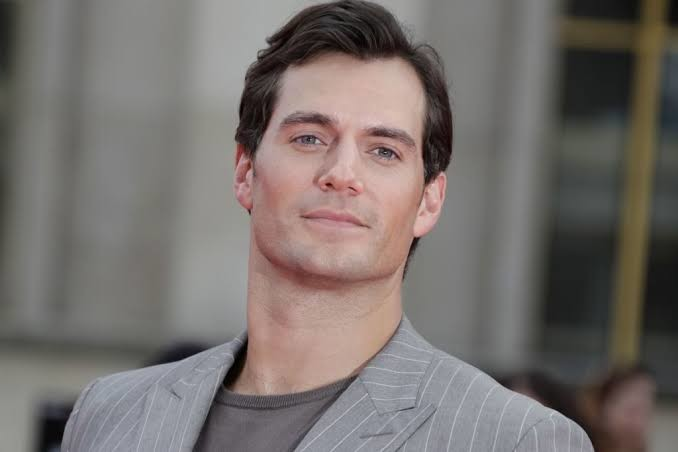 Henry Cavill plays the famous detective Sherlock Holmes