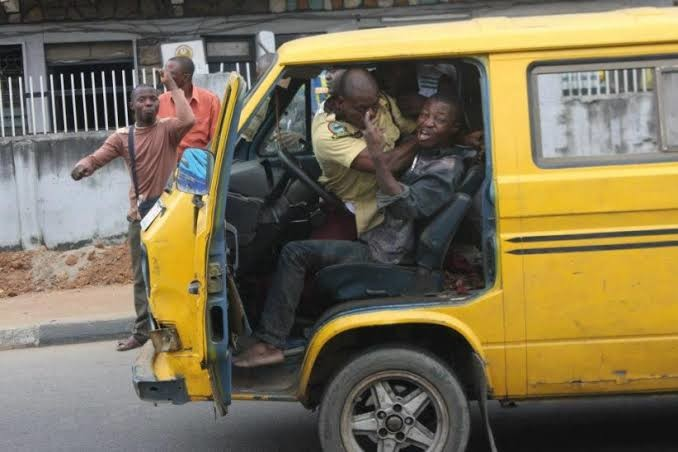 An official engaged in a scuffle with a bus driver