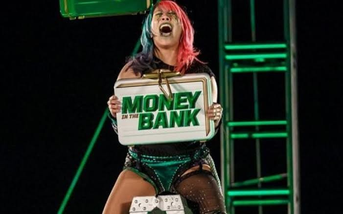 Asuka, the winner of this year's MONEY IN THE BANK, gets Lynch's championship belt