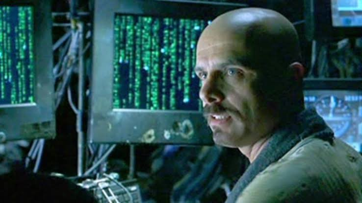 Pantoliano as Cypher in THE MATRIX