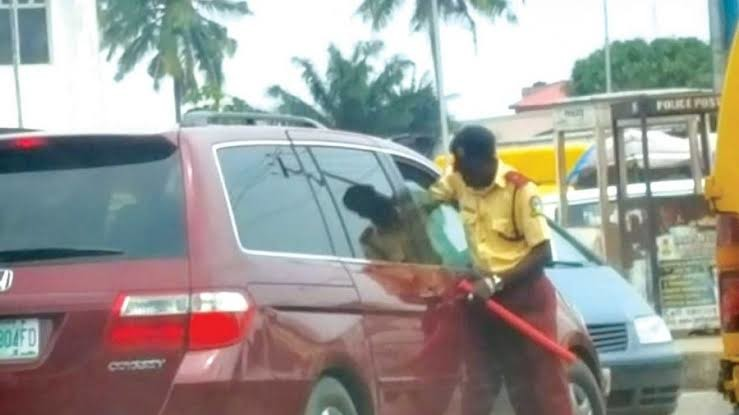 A LASTMA official stops a vehicle in Lagos
