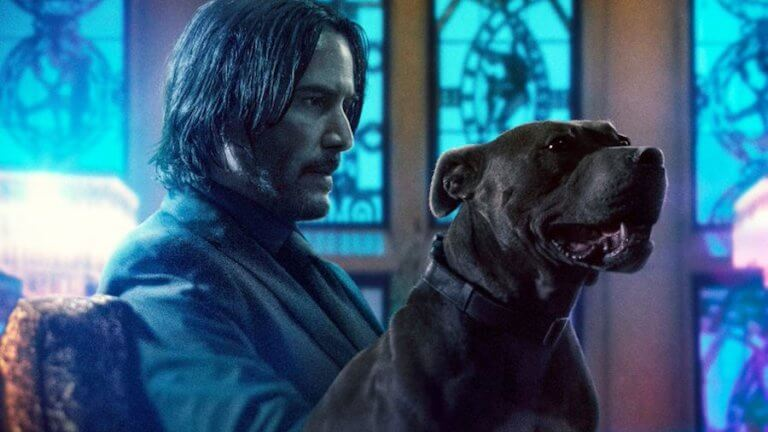 Reeves and his character's dog in JOHN WICK 3