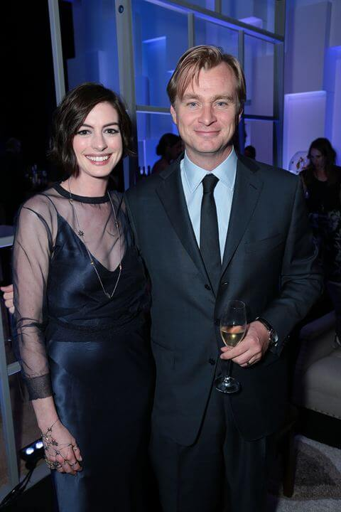 Anne Hathaway says director Christopher Nolan (with whom she is seen with here) hates chairs on the set of his films