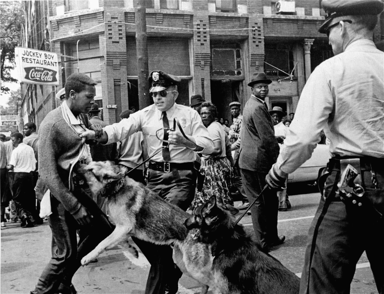 A photo showing police brutality against a black man