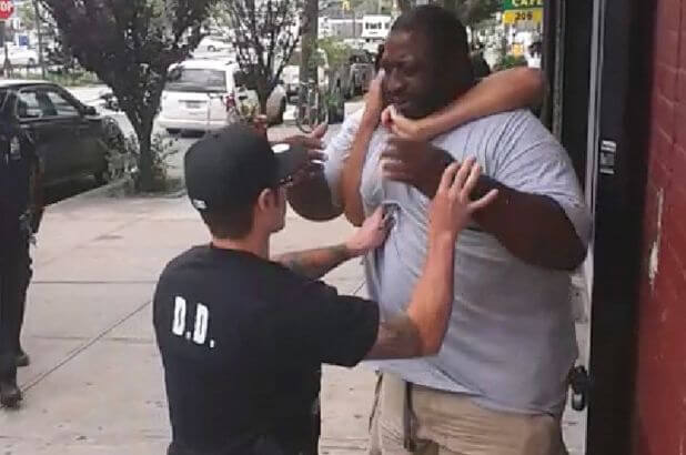 Eric Garner is being restrained by cops in 2014. He also pleaded for his life