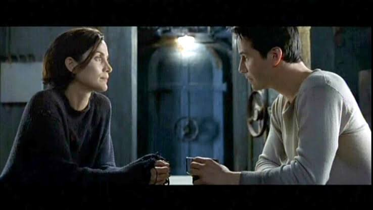 Carrie-Anne Moss and Keanu Reeves in THE MATRIX RELOADED
