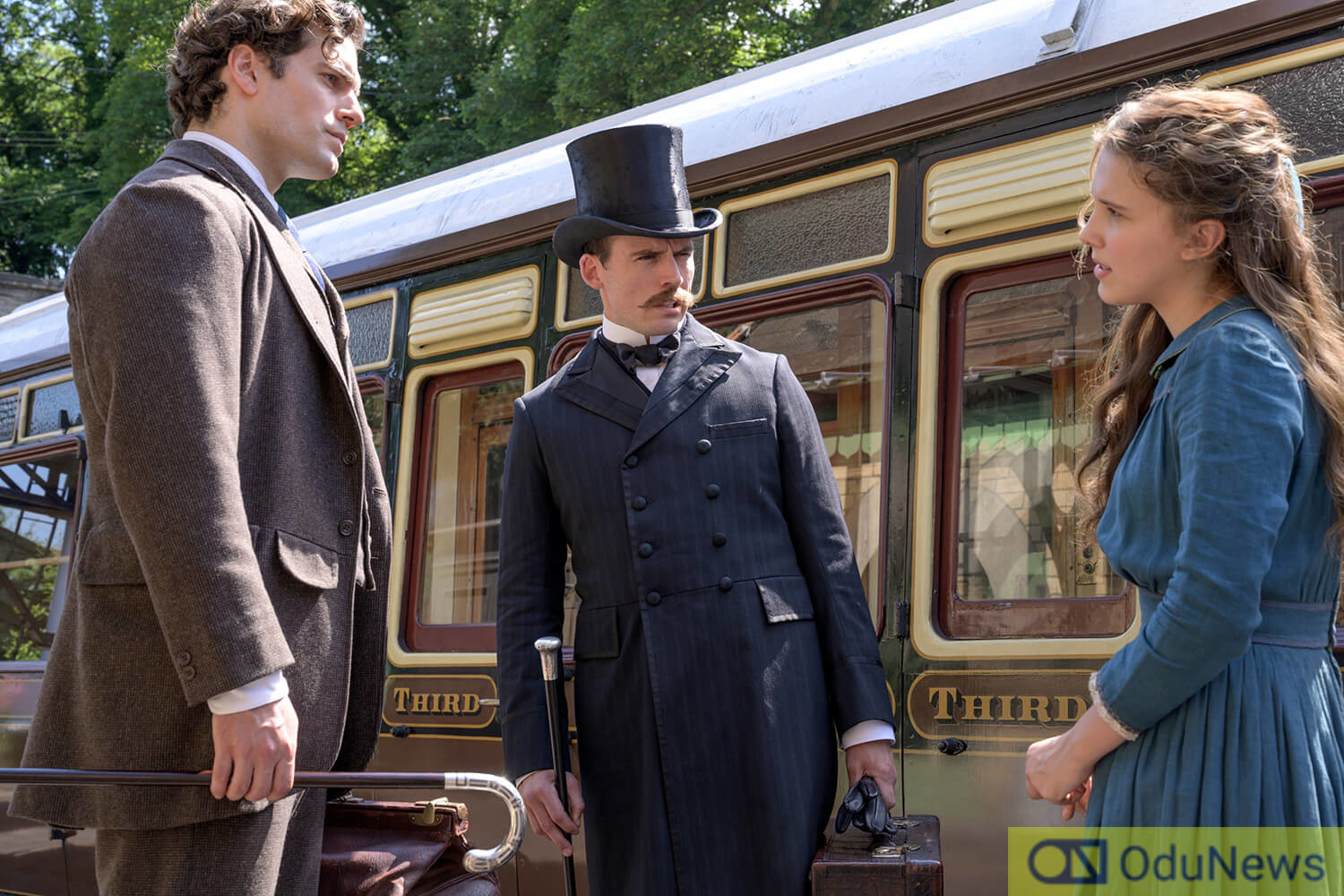 Henry Cavill, Sam Clafin, and Milly Bobby Brown in ENOLA HOLMES