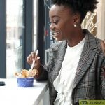 Young black lady eating ice cream